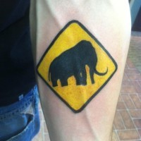 Mammoth in traffic sign tattoo on arm