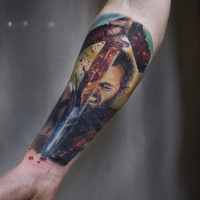 Man with sword tattoo on forearm