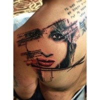 Medium size colored shoulder tattoo of lettering with woman face