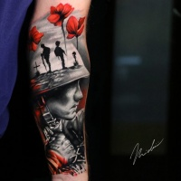 Military theme tattoo on arm