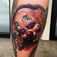 Neo traditional style colored leg tattoo of creepy clown