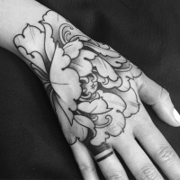 Nice black and grey flower tattoo on wrist