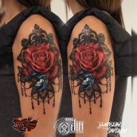 Nice girly tattoo with red rose and blue diamond on shoulder