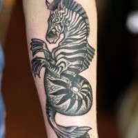 Nice uncolored zebra seahorse tattoo on arm