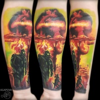 Nuclear explotions with man and dog tattoo on forearm
