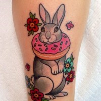 Old cartoons like big adorable animal bunny with flowers tattoo on leg