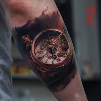 Old clock tattoo on forearm
