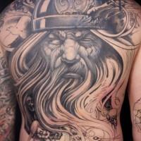 Old eyeless white-beared Viking warrior tattoo on back