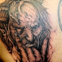 Old looking detailed tattoo of demonic monster portrait