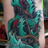 Old school anchor in green waves with don't drag me down lettering tattoo for men on rib-side
