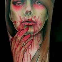 Old school style colored forearm tattoo of bloody zombie woman