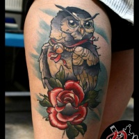 Owl and rose tattoo on thigh