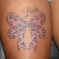 Pink bow with cheetah print and love quote tattoo on thigh