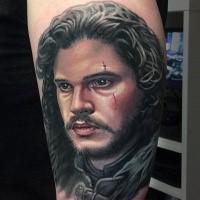 Ritratto del tatuaggio di John Snow sulla gamba