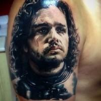 Ritratto del tatuaggio John Snow sulla spalla