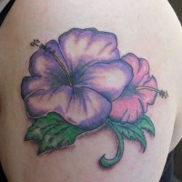 Purple-ink hawaiian hibiscus flower tattoo on upper arm