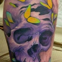 Purple skull and yellow moths tattoo on leg