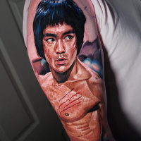 Realistic Bruce Lee tattoo on shoulder