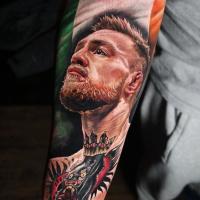 Realistic Conor McGregor portrait tattoo