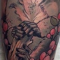 Realistic colorful lemur in flowers tattoo on arm