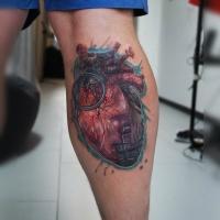 Realistic hear tattoo on leg