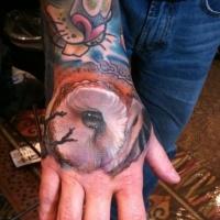 Realistic owl eyes tattoo on wrist