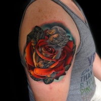 Realistic red rose and cherub tattoo on shoulder