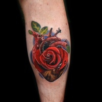 Realistic red rose and heart tattoo on leg
