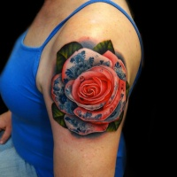 Realistic red rose tattoo on shoulder