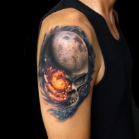 Realistic skull in space tattoo on shoulder