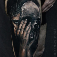Realistic woman and skull mask tattoo on thigh3