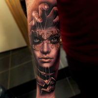 Realistic woman in mask and origami tattoo