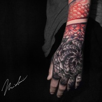 Red and gray geometric tattoo on wrist