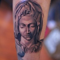 Religious  american classic michealangelo tattoo on forearm