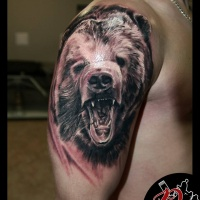 Roaring bear tattoo on shoulder