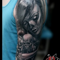 Santa muerte and skeleton tattoo on shoulder
