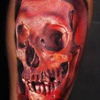 Scary red skull tattoo by Robert Zyla