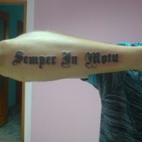 Semper in motu latin quote tattoo on arm