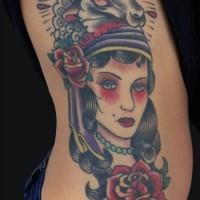 Sheep head and gyspy girl tattoo on side