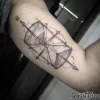 Sketch style hourglass tattoo on shoulder