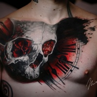 Skull and clock tattoo on chest