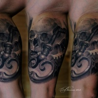 Skull and key tattoo on arm