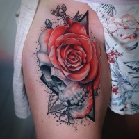 Skull and rose tattoo on thight