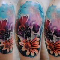 Skull with flowers tattoo on shoulder by Lehel Nyeste