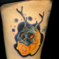 Skull with horns mask and rose tattoo