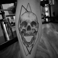 Skull with open jaw tattoo on leg