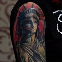 Statue Of Liberty tattoo on shoulder