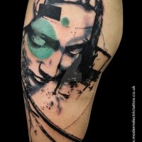 Statue like colored tattoo of woman head with circle