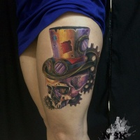 Steampuk style skull tattoo on leg