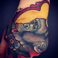 Super old school color-ink chimpanzee tattoo on hand